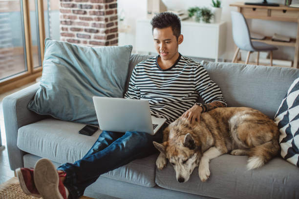 UIS Insurance & Investments - Condo Insurance - Man with Dog on a Couch.